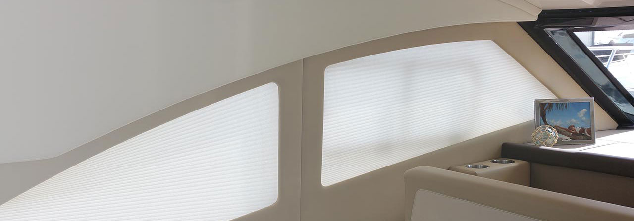 Custom Coral Honeycomb Boat Blinds Installed in a Yacht